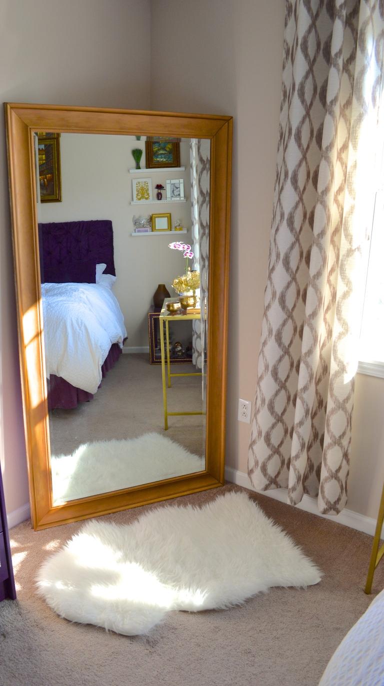 gilded mirror and sheepskin
