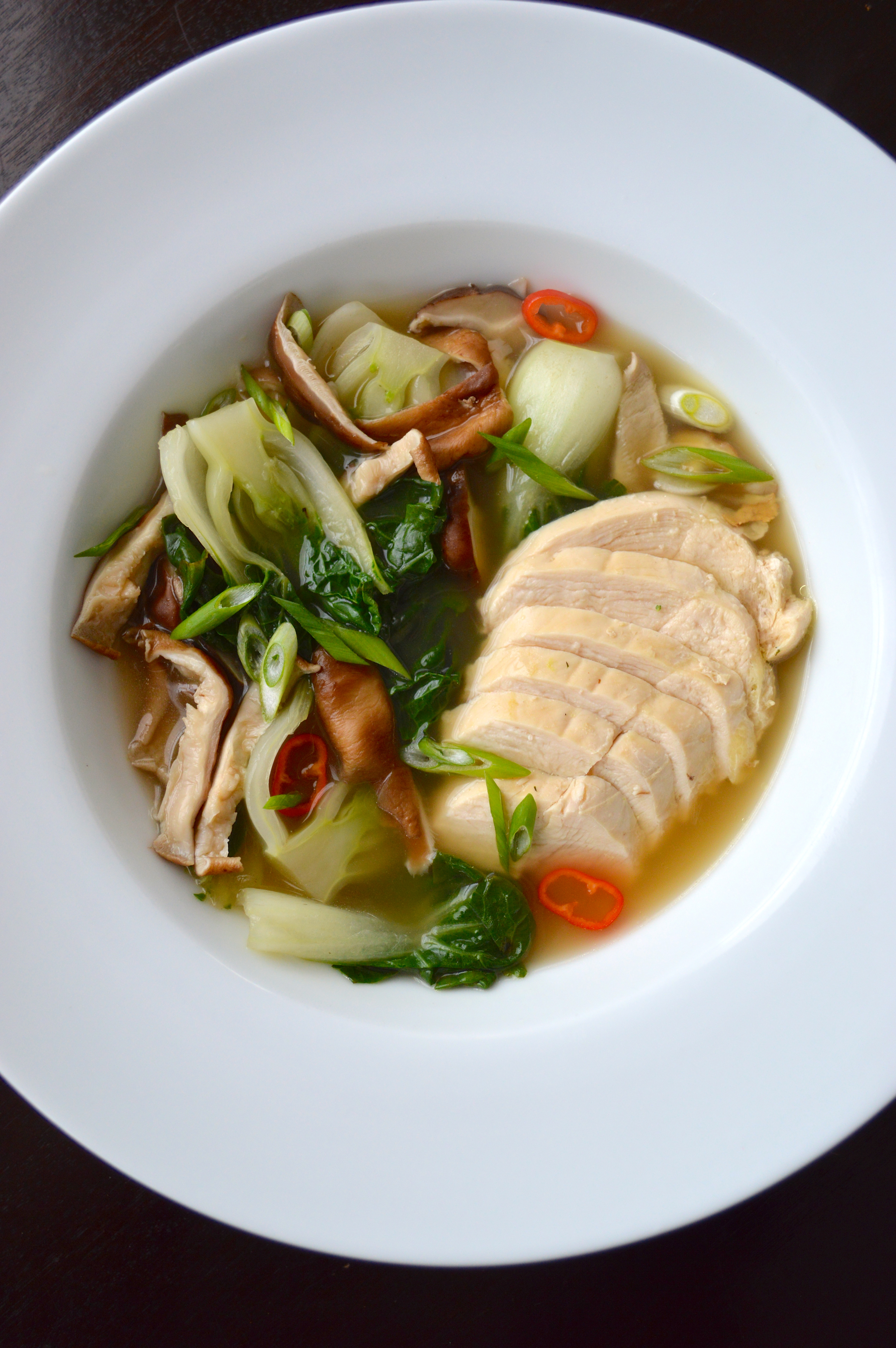 Poached chicken with bok choy in ginger broth when i got this clean eating cookbook i couldnt wait to make this recipe i love baby bok choy anything involving chicken especially when its poached forumfinder Images